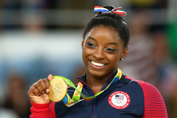Gold medalist Simone Biles of the United States celebrates on the podium at the medal ceremony for the Women's Floor on Day 11 of the Rio 2016 Olympic Games at the Rio Olympic Arena on August 16, 2016 in Rio de Janeiro, Brazil.