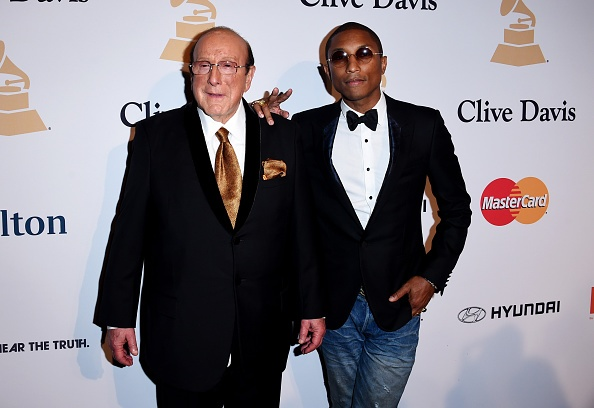 Clive Davis and Pharrell Williams arrive at The Grammy Awards Pre-Grammy Gala held at The Beverly Hilton Hotel on February 7, 2015 in Beverly Hills, California.