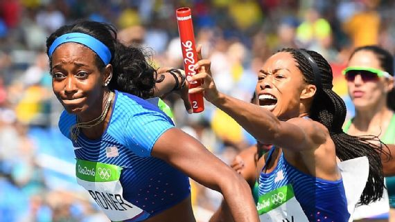 Allyson Felix of the U.S. attempts to hand the baton to English Gardner during a preliminary heat of the women's 4x100-meter relay on Thursday. Frack Fife/AFP/Getty Images