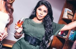lil kim with glass of wine