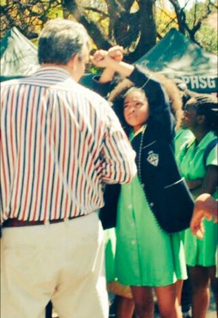 South African girls at Pretoria High School protest school policy forcing straightened hair