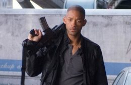 will smith with long gun on shoulder
