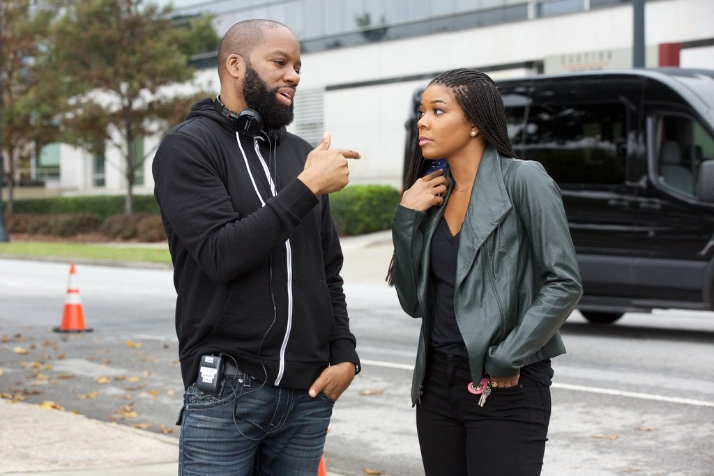 David E. Talbert with Gabrielle Union on the set of Almost Christmas, coming to theatres November 11th 2016