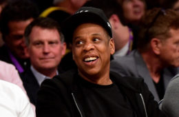 Jay-Z smiles as he sits courtside as the Los Angeles Lakers take on the Utah Jazz at Staples Center on April 13, 2016 in Los Angeles, California.