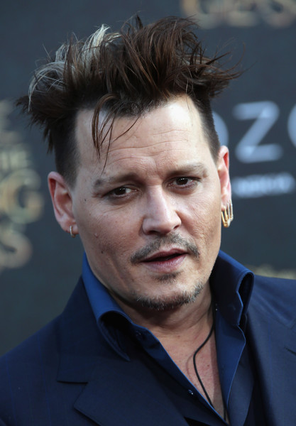 """Actor Johnny Depp attends the premiere of Disney's """"Alice Through The Looking Glass at the El Capitan Theatre on May 23, 2016 in Hollywood, California."""