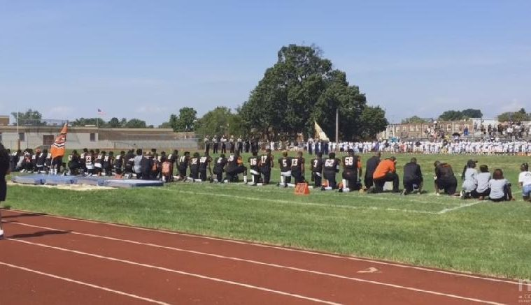 Brunswick High School football player takes a knee during National Anthem