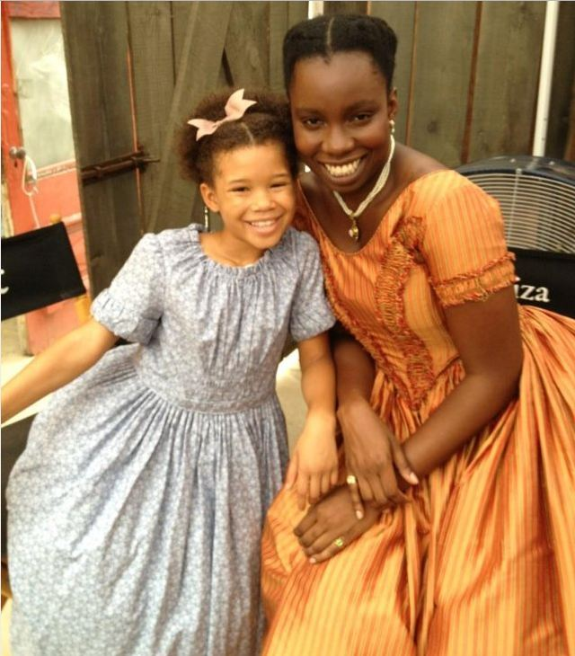 """Storm Reid as """"Emily"""" and Adepero Oduye as """"Eliza"""" on set of Twelve Years a Slave directed by Steve McQueen"""