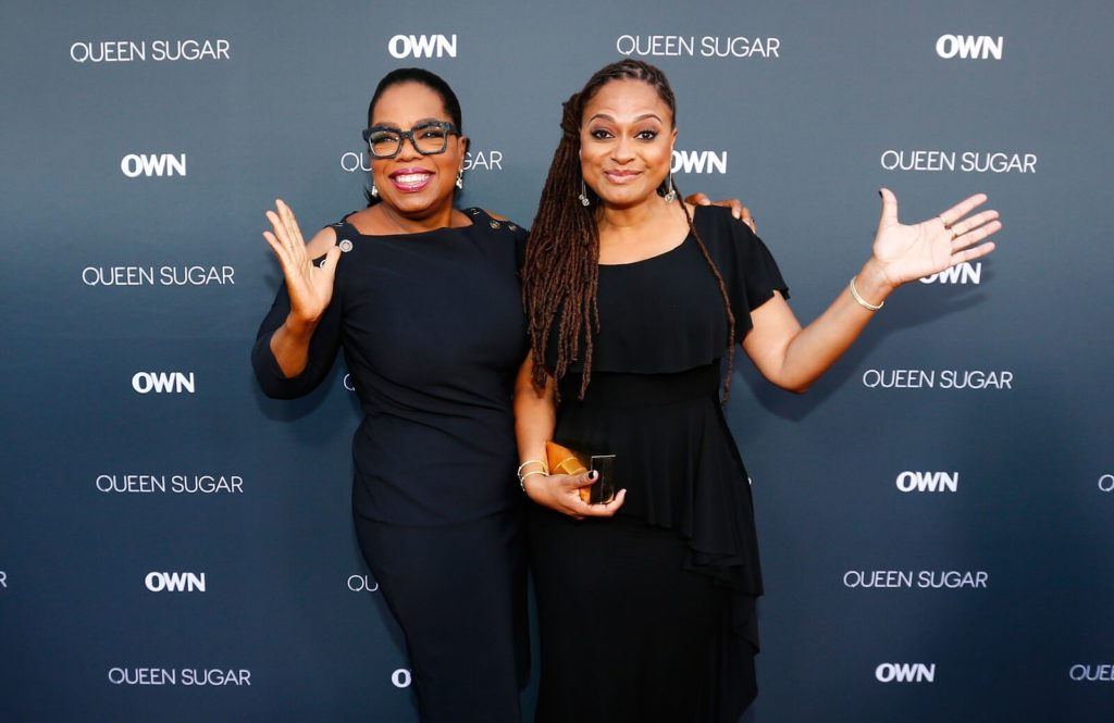 Oprah Winfrey and Ava DuVernay celebrating at the premiere of Queen Sugar.