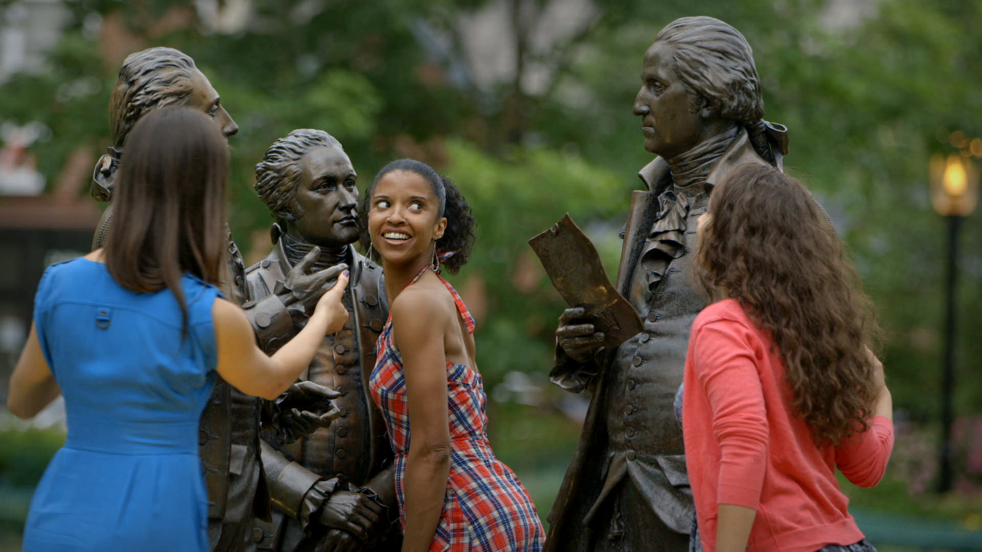 L to R: Phillipa Soo, Renée Elise Goldsberry, and Jasmine Cephas Jones at the Morristown Green in Morristown, NJ, in between filming scenes for Hamilton's America (photo: RadicalMedia).