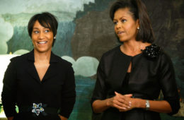 Former White House staffer Desiree Rogers (L) and First Lady Michelle Obama