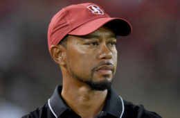 Golfer Tiger Woods looks on from the sidelines during an NCAA football game between the Washington State Cougars and Stanford Cardinal at Stanford Stadium on October 8, 2016 in Palo Alto, California.