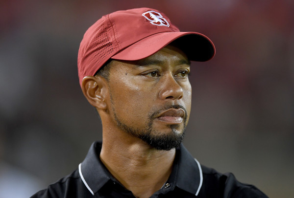 Tiger Woods postpones return saying his