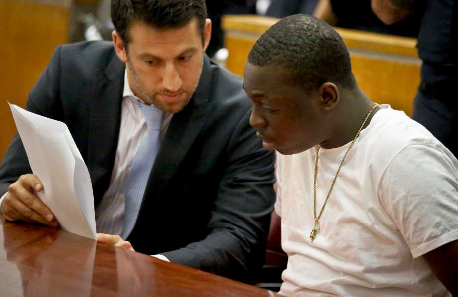 Rapper Bobby Shmurda, whose birth name is Ackquille Pollard, right, confers with his lawyer Alex Spiro in a Manhattan court on Wednesday Oct. 19, 2016, in New York.