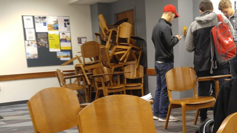 While students waited to hear word on the attacker's movements, some piled chairs against a door to block him from getting in.