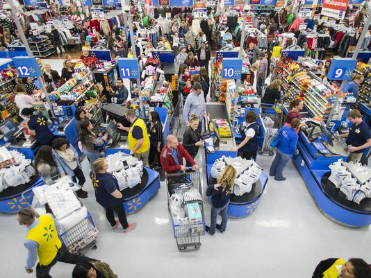 Customers check out at a Walmart store in Bentonville, Arkansas, with their Black Friday items on Thursday, Nov. 24, 2016. This year, Walmart stocked its digital and physical aisles with more than 1.5 million televisions, nearly two million tablets and computers and three million video games. (Photo: Gunnar Rathbun, AP)