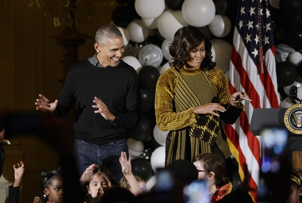 """U.S. President Barack Obama and first lady Michelle Obama dance to Michael Jackson's song """"Thriller"""" during a Halloween event in the East Room of the White House October 31, 2016 in Washington, DC."""