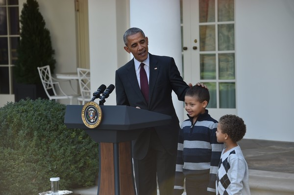 President Barack Obama stands with his nephews Austin and Aaron Robinson before he pardons the National Thanksgiving Turkey in the Rose Garden of the White House in Washington, DC, on November 23, 2016.