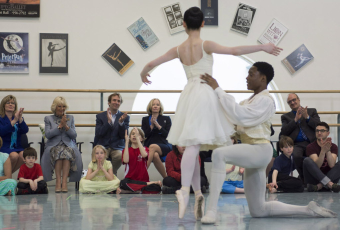 Minister of Canadian Heritage and Official Languages Shelly Glover, left to right, Camilla, the Duchess of Cornwall, and Canada's Royal Winnipeg Ballet Artistic Director André Lewis watch Royal Winnipeg Ballet Professional Division students Akanbi Babatunde and Saeka Shirai perform La Fille mal gardée while touring the Royal Winnipeg Ballet in Winnipeg Wednesday, May 21, 2014. THE CANADIAN PRESS/David Lipnowski