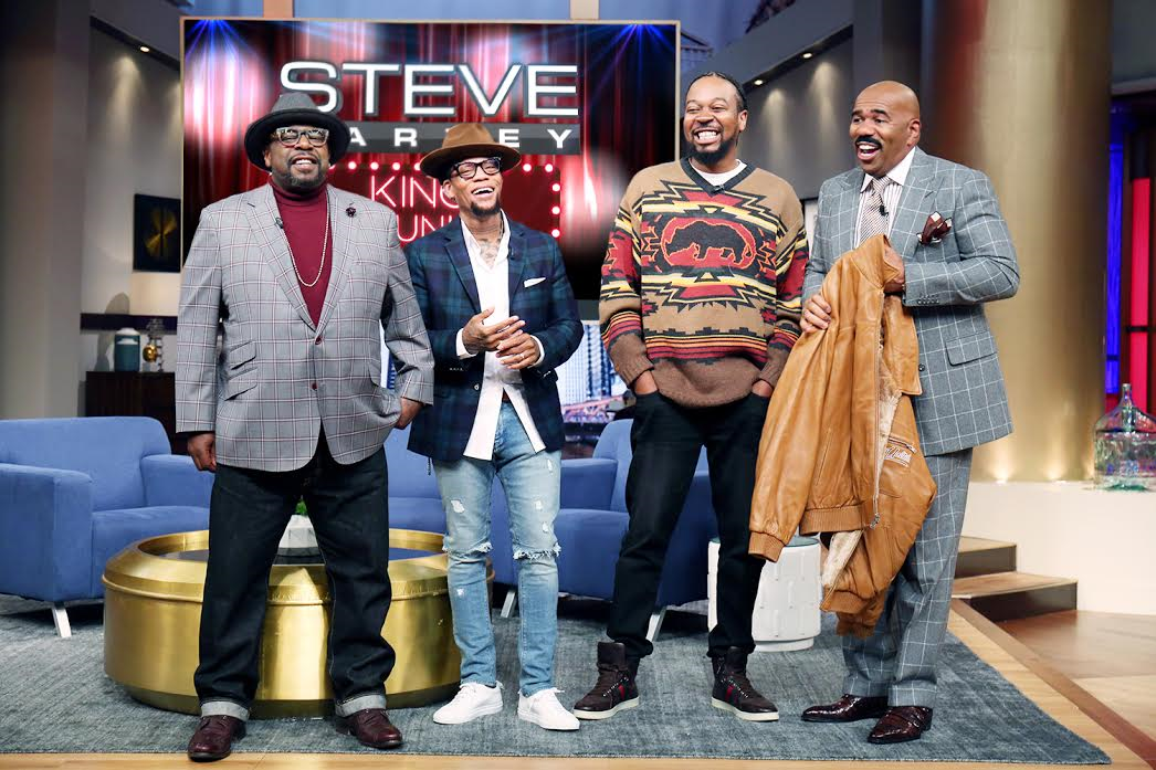 """L to R, Cedric The Entertainer, D.L. Hughley, """"Boogie"""" and Steve Harvey, holding the leather jacket that """"Boogie"""" wore in the movie"""