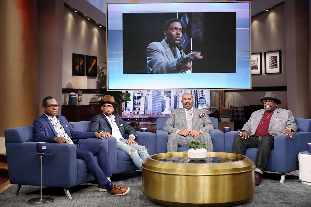 Image #2: Sitting L to R, Guy Torry, D.L. Hughley, Steve Harvey, Cedric The Entertainer. In the Screen, Bernie Mac.