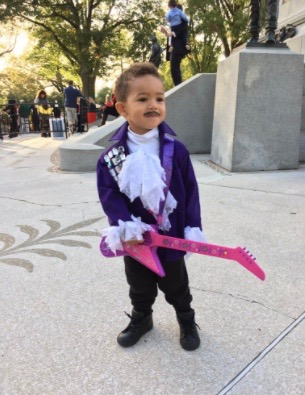 Little boy dressed as Prince for Halloween at the White House