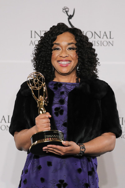 """Shonda Rhimes pose with the """"Founders"""" award in the press room during the 44th International Emmy Awards at New York Hilton on November 21, 2016 in New York City."""