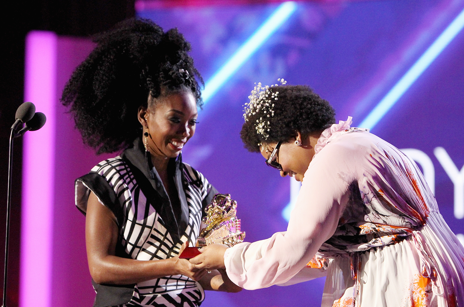 Brandy accepts the Lady of Soul Award from Jill Scott onstage during the 2016 Soul Train Music Awards at the Orleans Arena on Nov. 6, 2016 in Las Vegas.