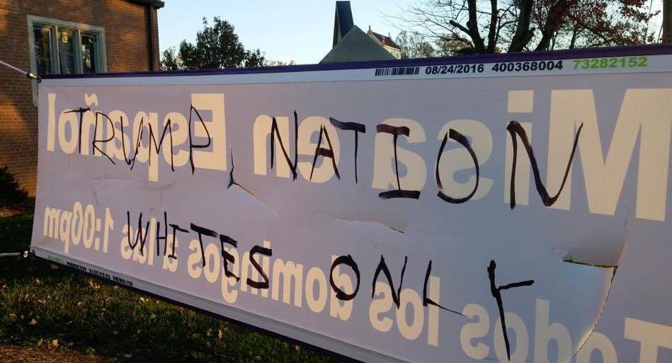 """Vandals used a black magic marker to write """"Trump Nation Whites Only"""" on the back of a sign advertising the weekly Spanish-language mass at Church of Our Saviour in Silver Spring, Maryland. The hate speech was discoved early on the morning of Nov. 13. Photo: Facebook"""