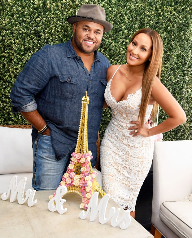 Adrienne Bailon and Israel Houghton attend their wedding shower at Fig and Olive in 2016. Vivien Killilea/Getty Images