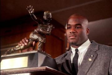 FILE--Colorado's Rashaan Salaam poses with the 1994 Heisman Trophy which he was awarded Saturday, Dec. 10, 1994, at the Downtown Athletic Club in New York. (AP Photo/Adam Nadel)