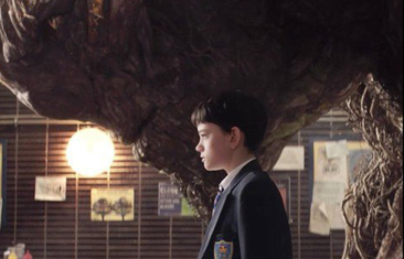 Conor (Lewis MacDougall) and the Monster (Liam Neeson) in 'A Monster Calls.'