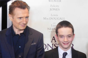 Liam Neeson and Lewis MacDougall at AMC New York premiere.