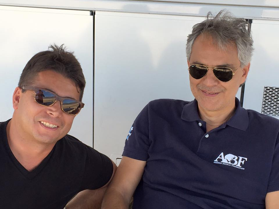oscar generale enjoys a candid moment on the set with andrea bocelli generale is executive - Executive Producer Music