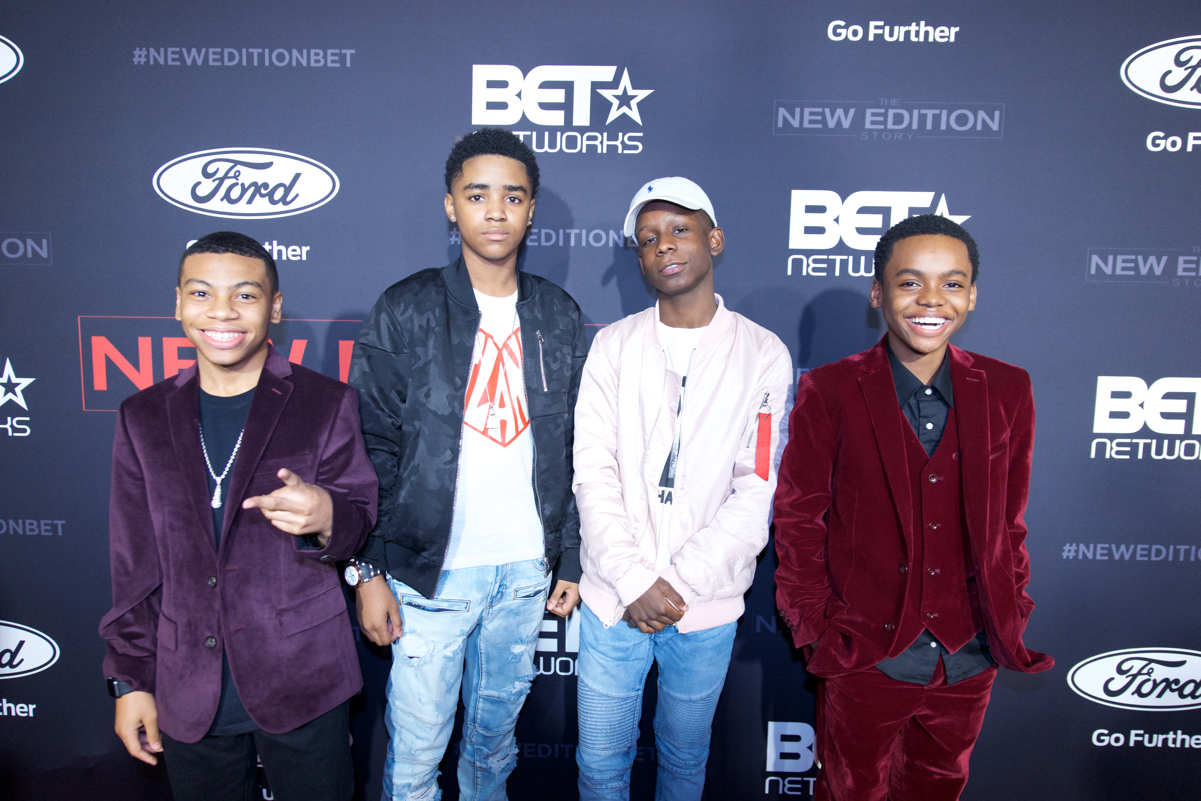 (L-R) Dante Hoagland (portrays Michael Bivins), Myles Truitt (portrays Ronnie Devoe), Tyler Williams (portrays Bobby Brown) and Jahi Winston (portrays Ralph Tresvant) at the premiere of BETs 'The New Edition Story' (Photo by Earl Gibson III/Getty Images for BET)