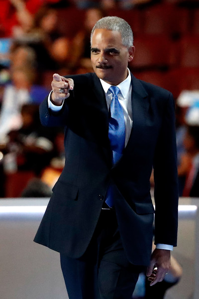 Former U.S. Attorney General Eric Holder walks on stage to delivers remarks on the second day of the Democratic National Convention at the Wells Fargo Center, July 26, 2016 in Philadelphia, Pennsylvania