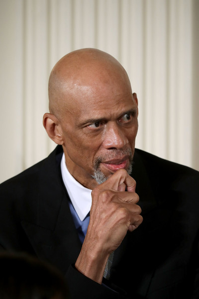 National Basketball Association all-time leading scorer and social justice advocate Kareem Abdul-Jabbar listens before being awarded the Presidential Medal of Freedom by U.S. President Barack Obama during a ceremony in the East Room of the White House November 22, 2016 in Washington, DC.