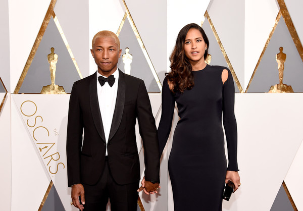 Musician Pharrell Williams (L) and Helen Lasichanh attend the 88th Annual Academy Awards at Hollywood & Highland Center on February 28, 2016 in Hollywood, California.