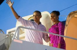 barack-michelle-obama-waving-from-airplane-ap