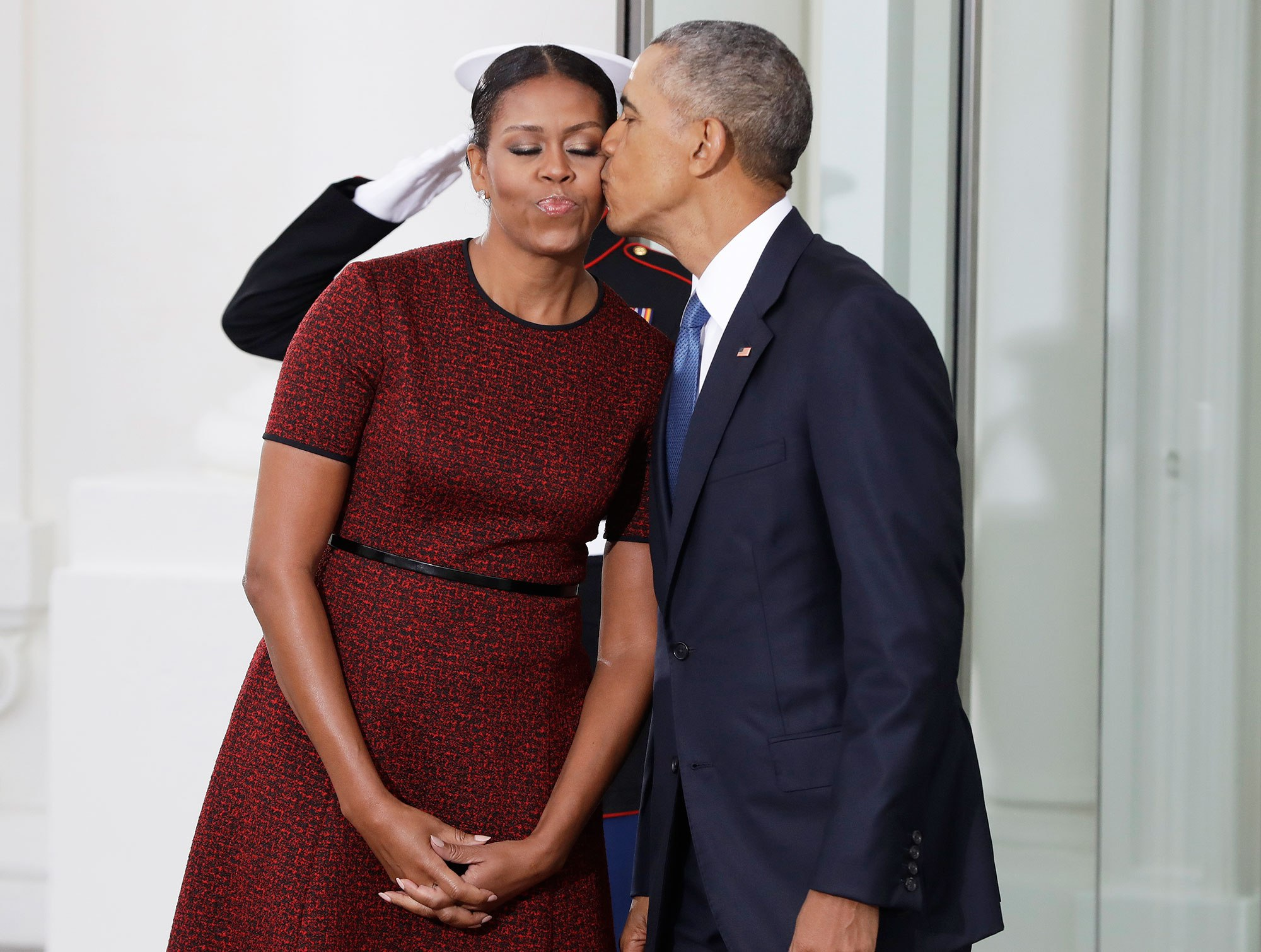 Its really happening the obamas greet new white house occupants president barack obama kisses first lady michelle obama as they await for the arrival of president m4hsunfo