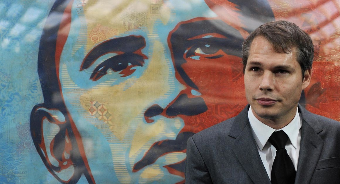 "Shepard Fairey in front of the ""Hope"" poster of Barack Obama he created 2008"