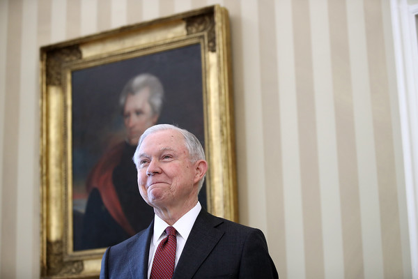Jeff Sessions listens as U.S. President Donald Trump introduces him prior to being sworn in as the new U.S. Attorney General in the Oval Office of the White House February 9, 2017 in Washington, DC.
