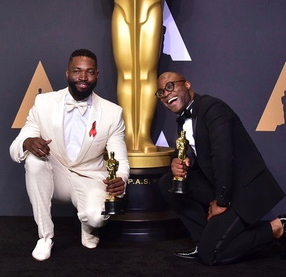 Writer/director Barry Jenkins (L) and writer Tarell Alvin McCraney pose in the press room with the Best Adapted Screenplay award for 'Moonlight' during the 89th Oscars on February 26, 2017 in Hollywood, California