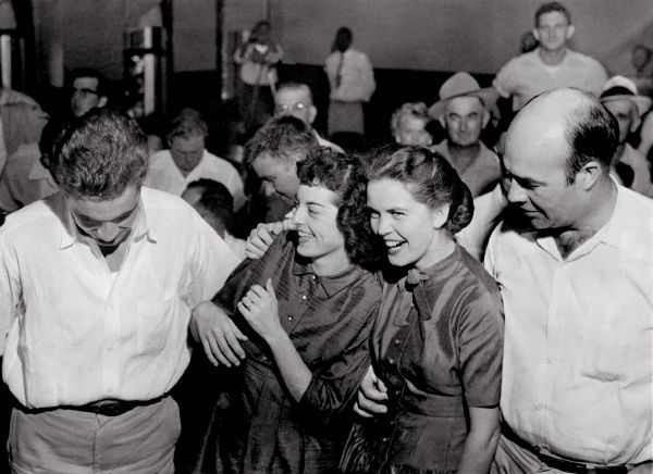Roy and Carolyn Bryant (left) with Mr. & Mrs. J.W. Milam laughing at the verdict in the murder of Emmett Till in Sumner, Miss. Friday, September 23, 1955.
