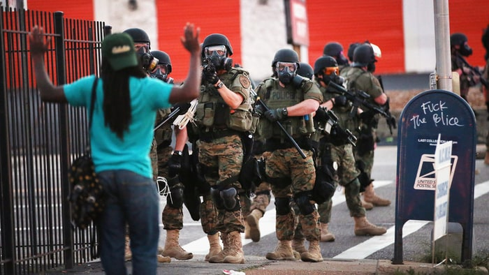 Police force protestors from the business district into nearby neighborhoods in Ferguson, Missouri on August 11th, 2014. Credit: Scott Olson/Getty