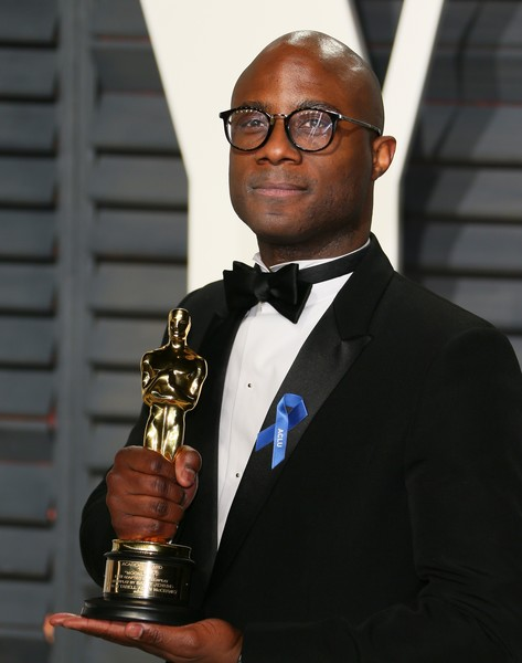 US writer/director Barry Jenkins poses with the Best Adapted Screenplay award for 'Moonlight' he arrives to the Vanity Fair Party following the 88th Academy Awards at The Wallis Annenberg Center for the Performing Arts in Beverly Hills, California, on February 26, 2017. / AFP / JEAN-BAPTISTE LACROIX