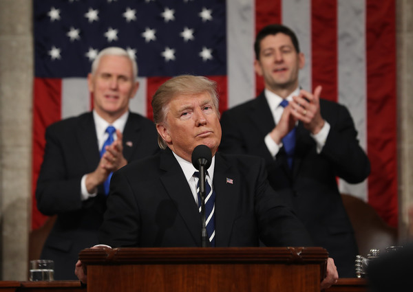 U.S. Vice President Mike Pence (L) and Speaker of the House Paul Ryan (R) applaud after U.S. President Donald J. Trump (C) delivers his first address to a joint session of the U.S. Congress on February 28, 2017 in the House chamber of the U.S. Capitol in Washington, DC.