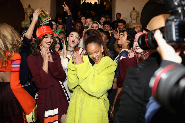Rihanna poses with models backstage before FENTY PUMA by Rihanna Fall / Winter 2017 Collection at Bibliotheque Nationale de France on March 6, 2017 in Paris, France.