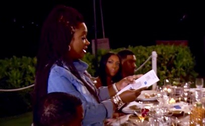 Real Housewives of Atlanta: Kandi Burruss reads a printout of texts sent from Porsha Williams, who looks on
