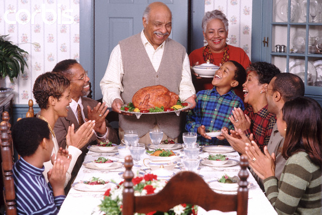 African American Family Celebrating Thanksgiving --- Image by © Ariel Skelley/CORBIS