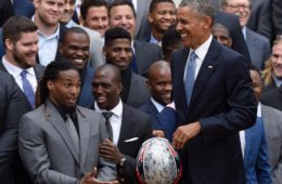 President Barack Obama holds a signed New England Patriots football helmet during a ceremony on the South Lawn of the White House in Washington, Thursday, April 23, 2015, to honor the Super Bowl Champion New England Patriots for their Super Bowl XLIX victory. (AP Photo/Susan Walsh)